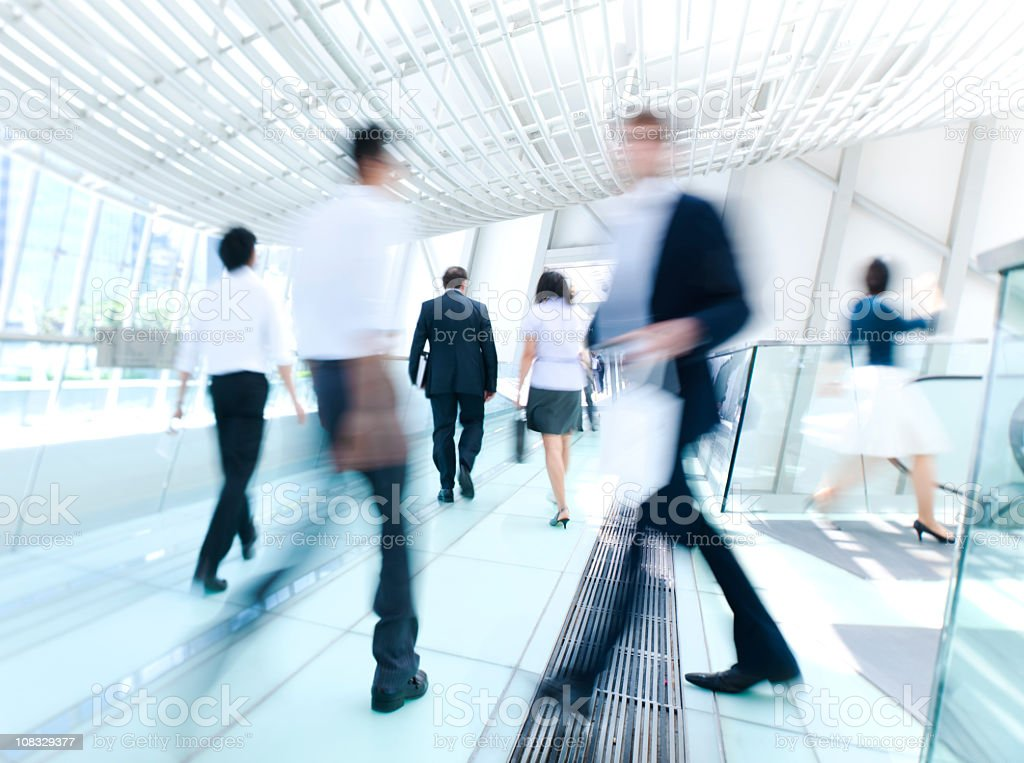Blurred photo of business people in a rush at work royalty-free stock photo