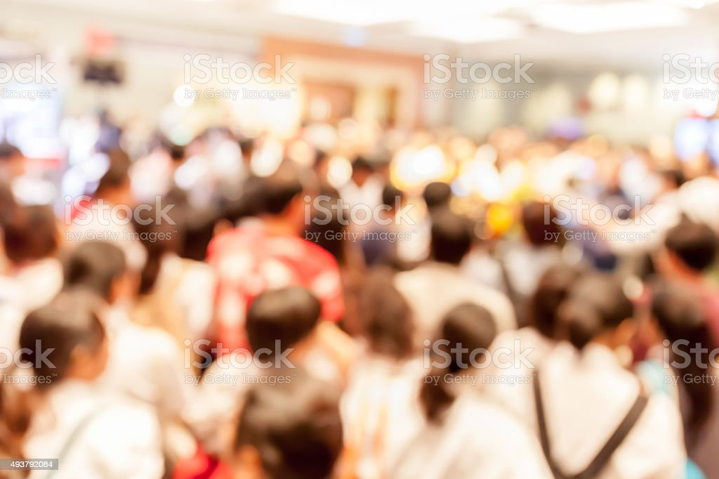 Blurred photo of crowd people in press conference event hall. stock photo