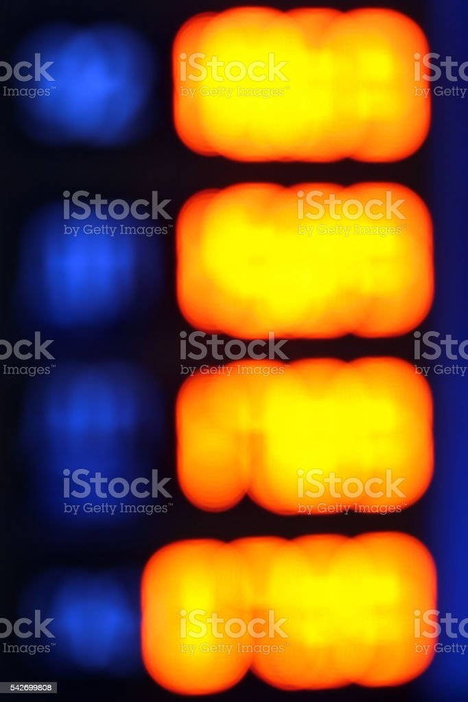 Blurred photo of gasoline station glowing price sign stock photo