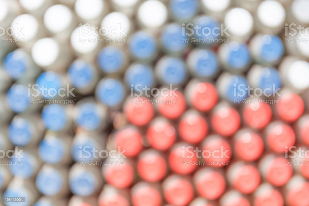 Blurred photo of many pattern bottle stoppers. stock photo