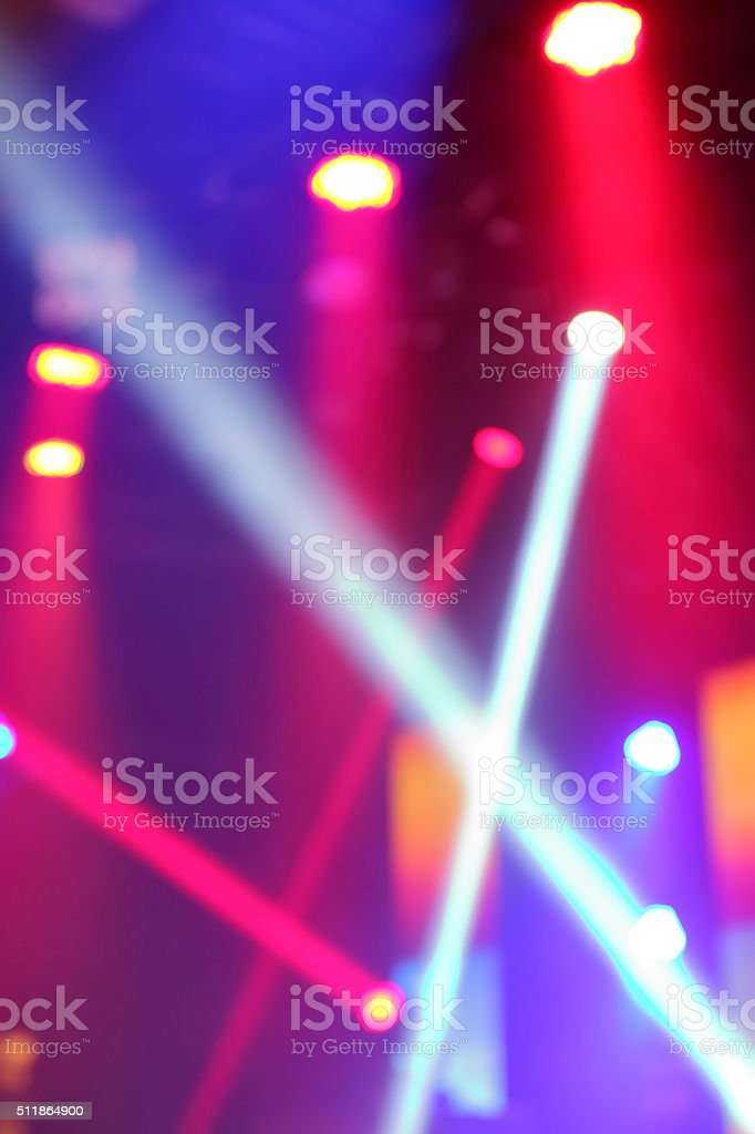 Blurred photo of stage lights in live concert hall. stock photo
