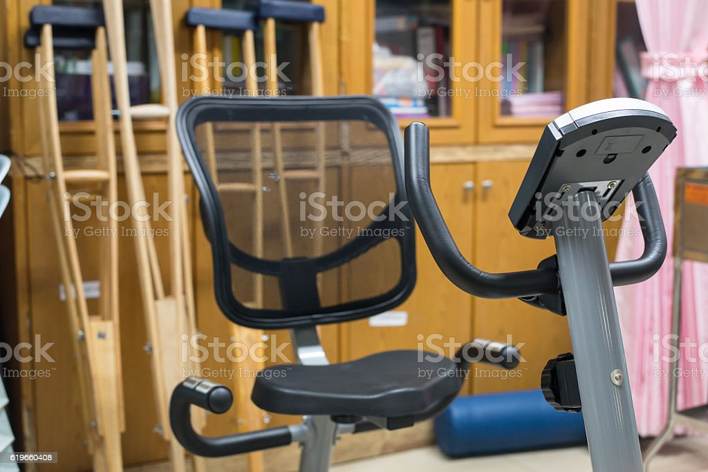 Blurred Physical therapy rehabilitation exercise equipment in ho stock photo