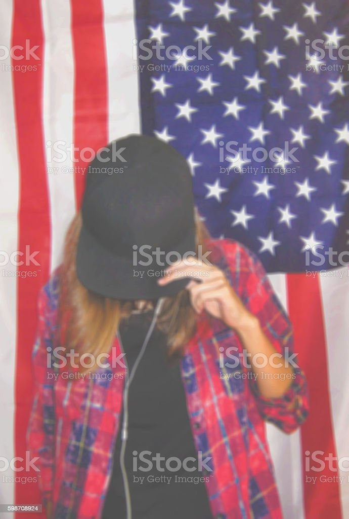 Blurred portrait of young girl against american flag background stock photo