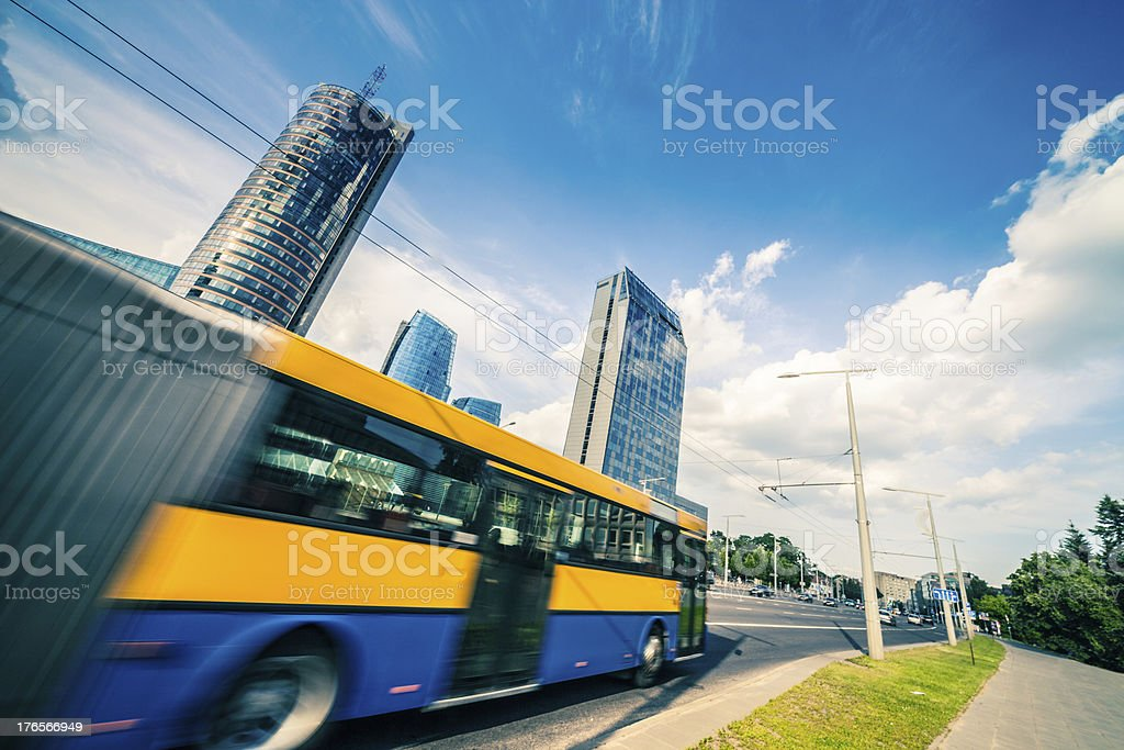 Blurred public bus in financial district royalty-free stock photo