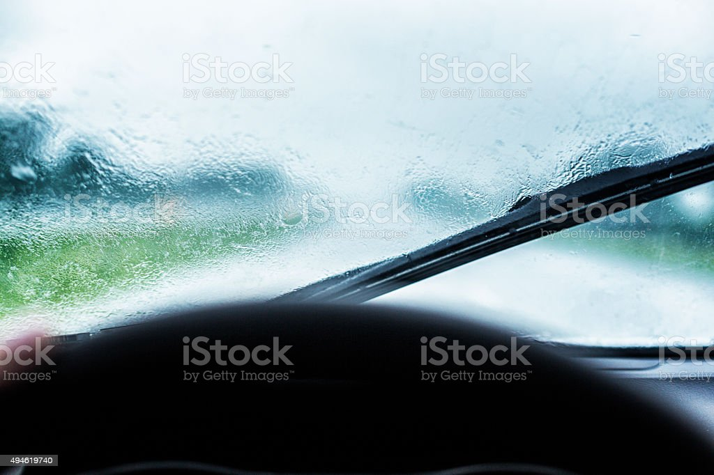 Looking through the windshield of a speeding car during a torrential...