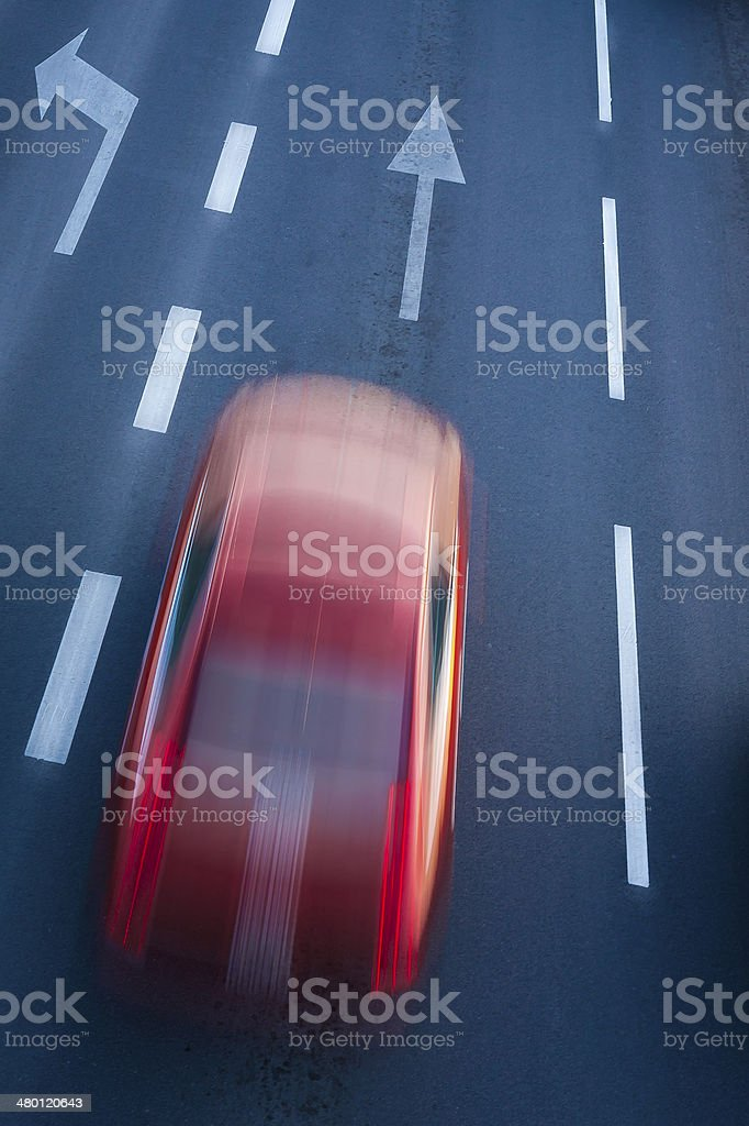 Blurred red car, danger of speed in city. stock photo