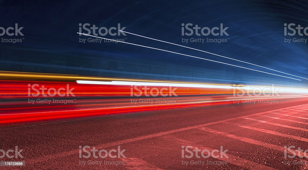 Blurred red, yellow, white and blue moving lights stock photo