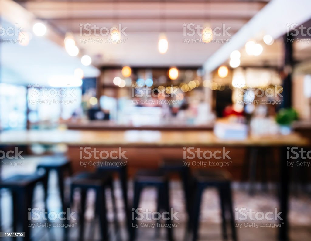 Blurred Restaurant Shop interior Table and seats with People stock photo