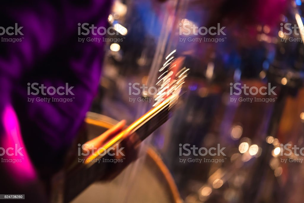 Blurred rock music background, guitar player stock photo