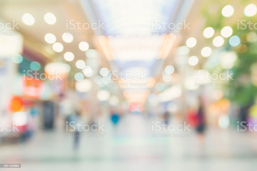 Blurred shopping mall with people walking stock photo