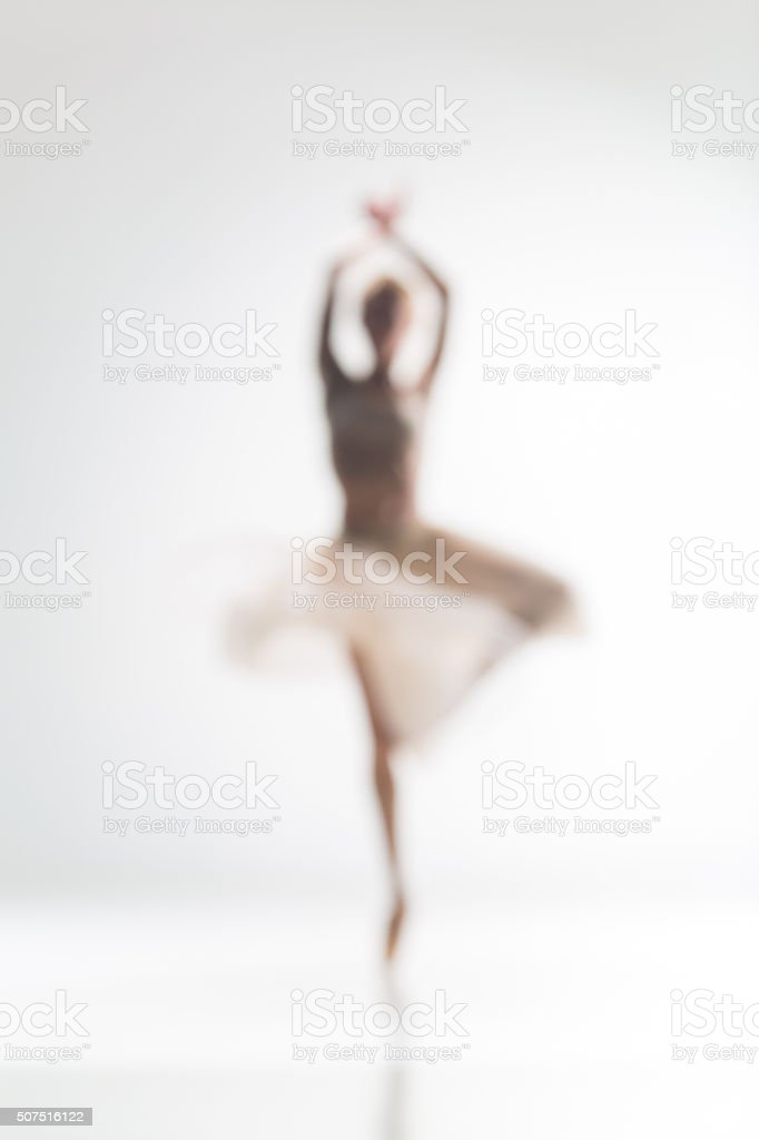 Blurred silhouette of ballerina on white background stock photo