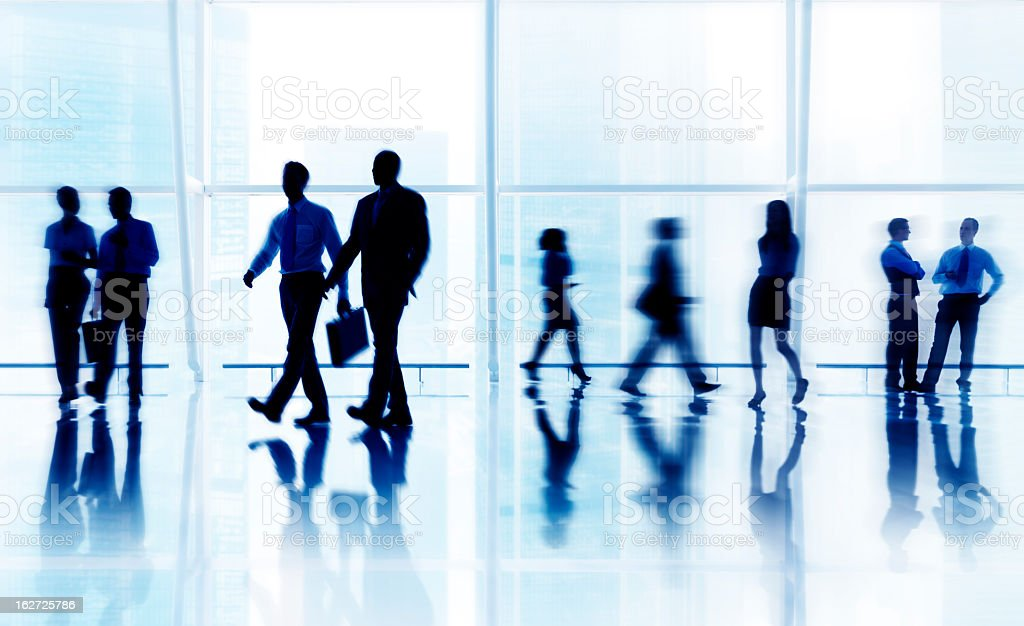 Blurred silhouettes of business people in the city royalty-free stock photo