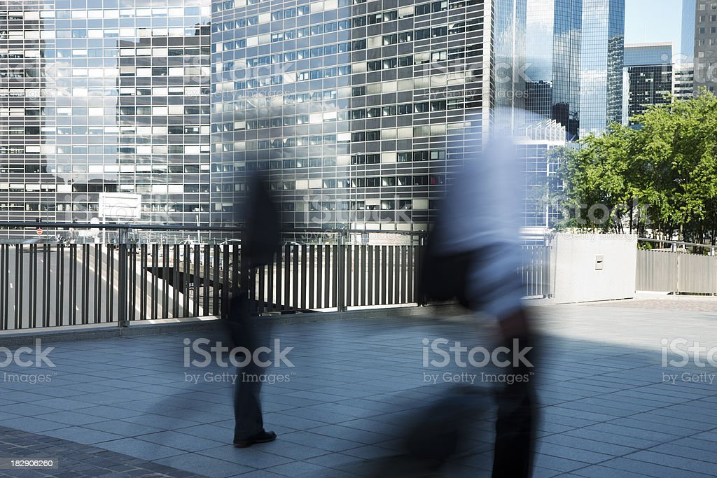 Blurred Silhouettes of Two Businessmen in Financial District royalty-free stock photo