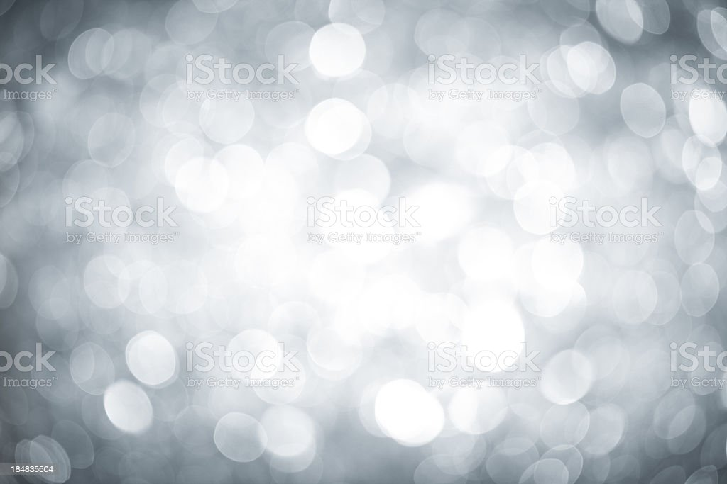 Blurred silver sparkles with darker corners and bright center royalty-free stock photo
