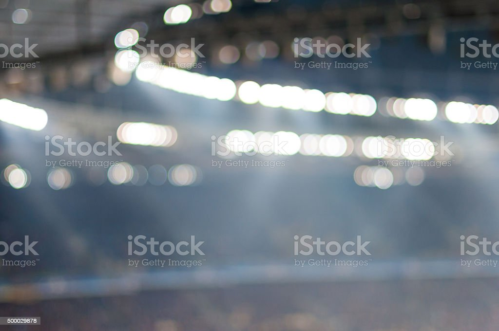 Blurred soccer stadium or ather sport arena at night with stock photo