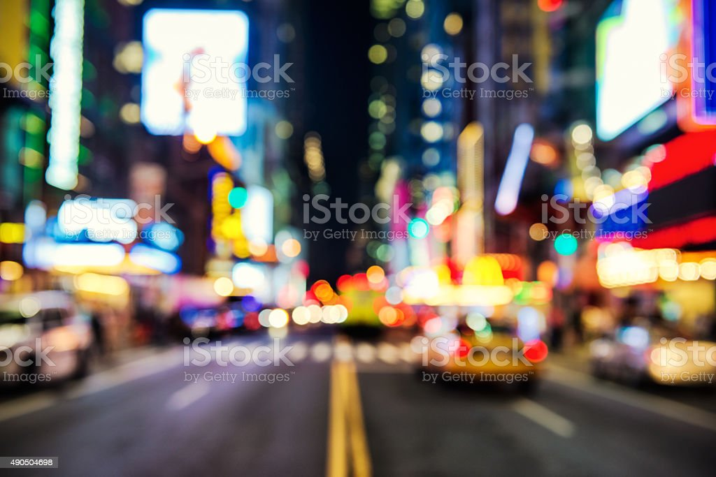 Blurred street illumination and night lights of New York City stock photo