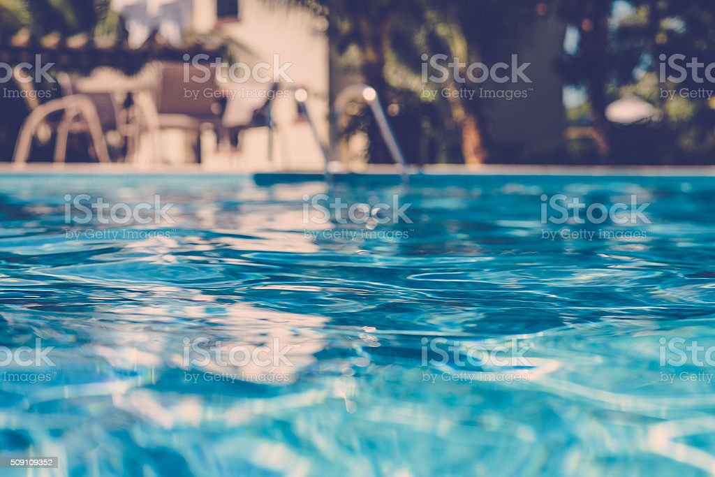 blurred surface view on blue swimming pool stock photo
