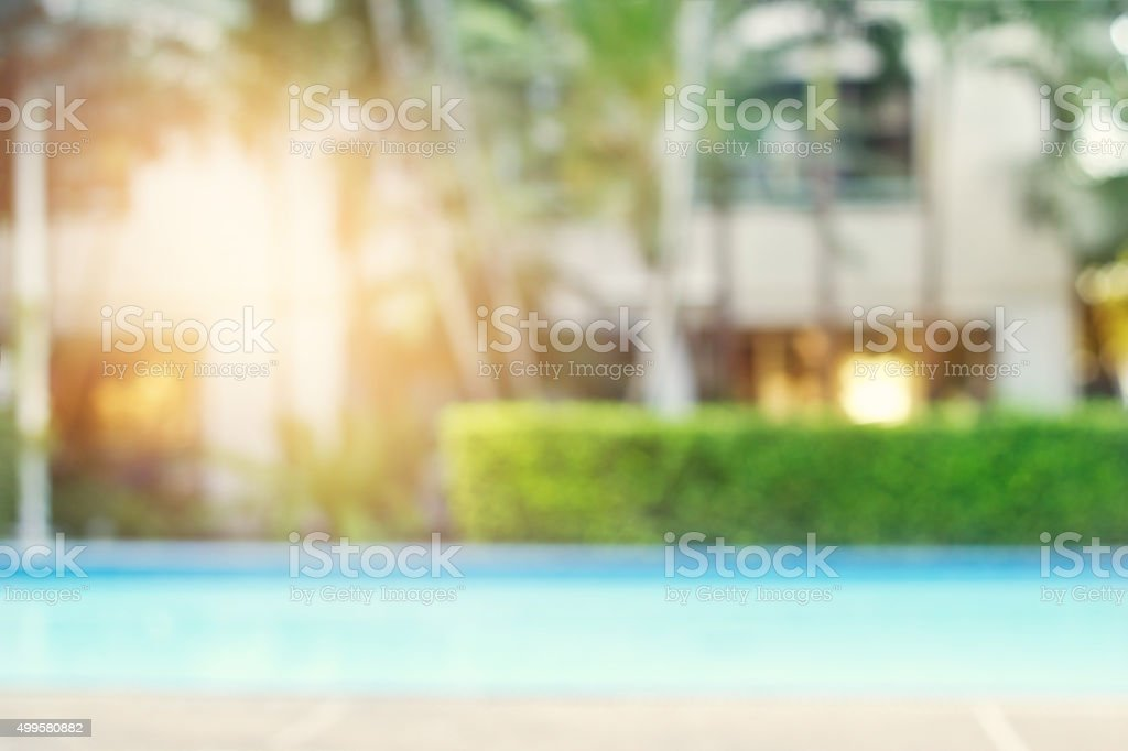 blurred swimming pool on nature and hotel background stock photo