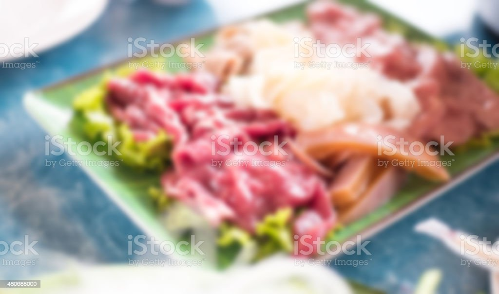 Blurred Thai food,fresh raw beef meat in restaurant. stock photo