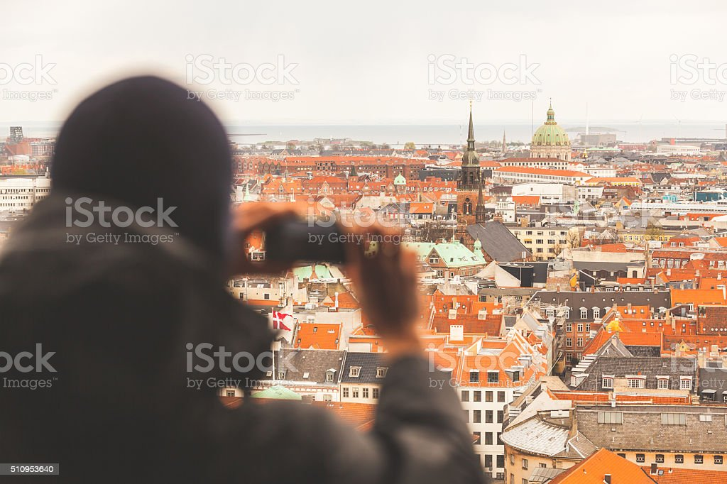 Blurred tourist taking an aerial photo of Copenhagen stock photo