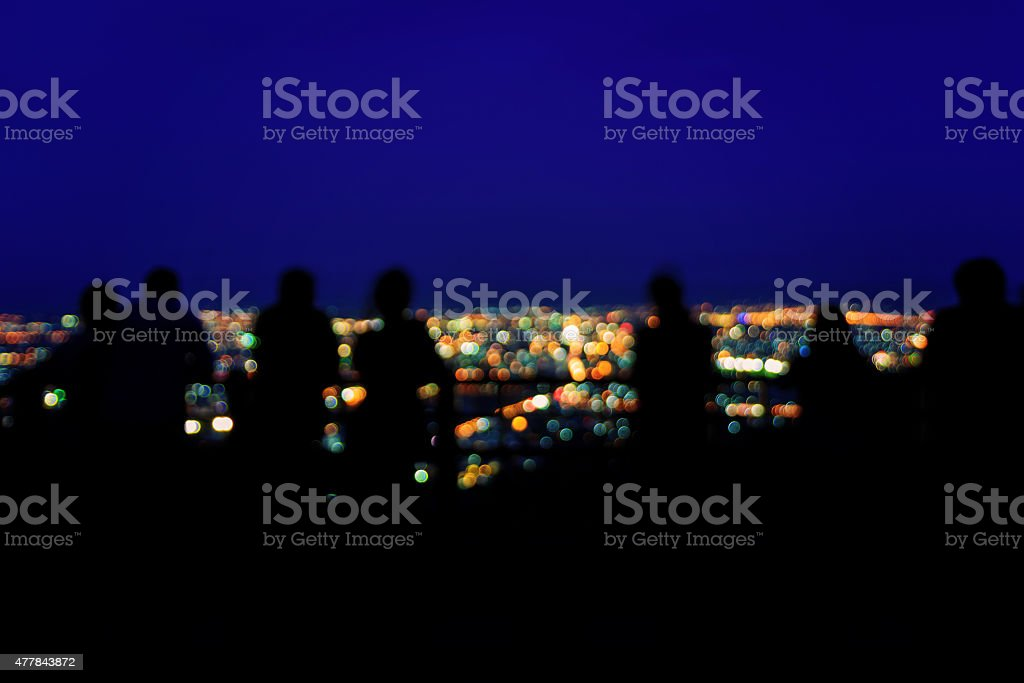 Blurred tourists and city lights royalty-free stock photo