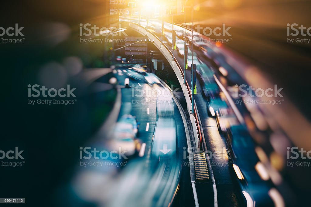 blurred traffic  in central district stock photo
