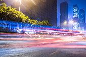 blurred traffic light trails on road at night