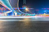 blurred traffic light trails on road
