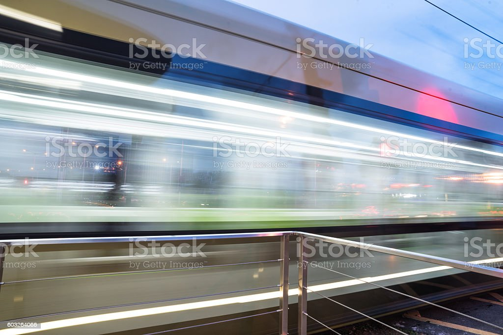 Blurred train at night leaving station stock photo