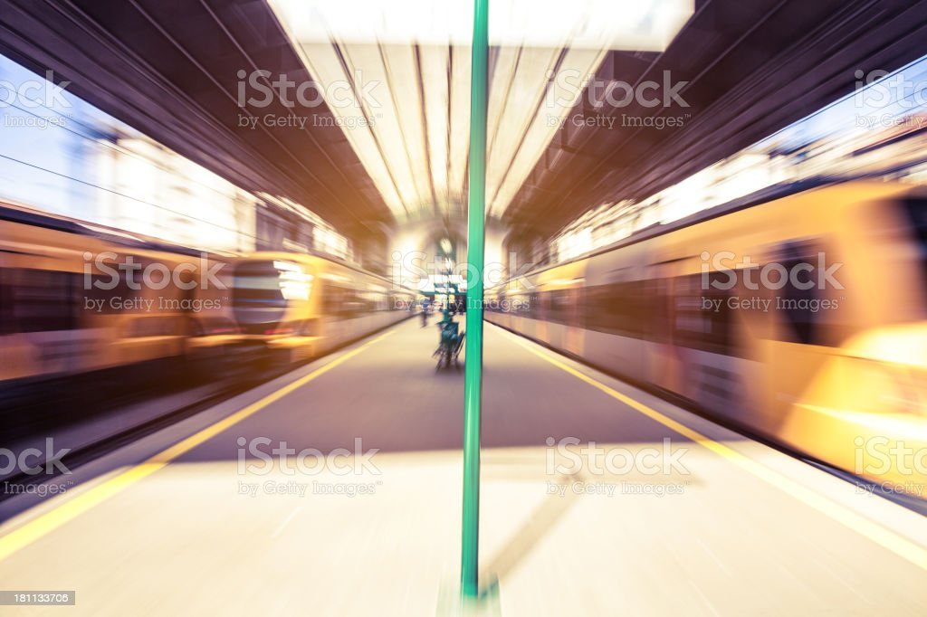 Blurred trains leaving the railway station stock photo
