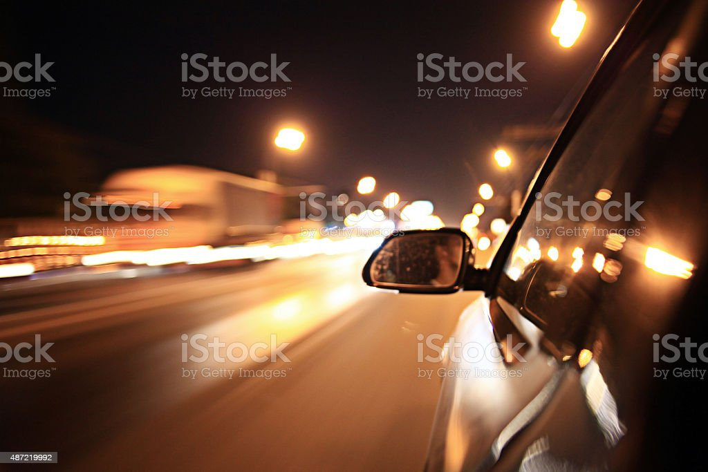 blurred urban look of the car movement nights stock photo
