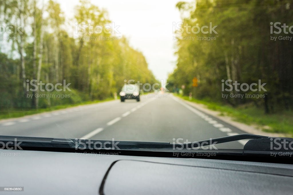 Blurred view from a moving car stock photo