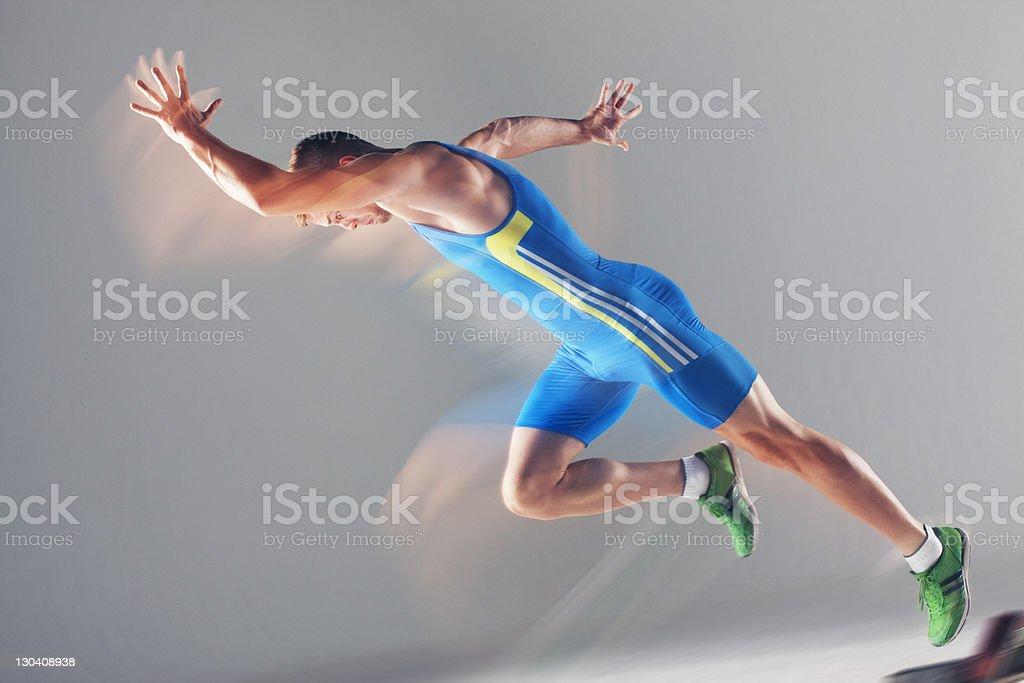 Blurred view of athlete running stock photo