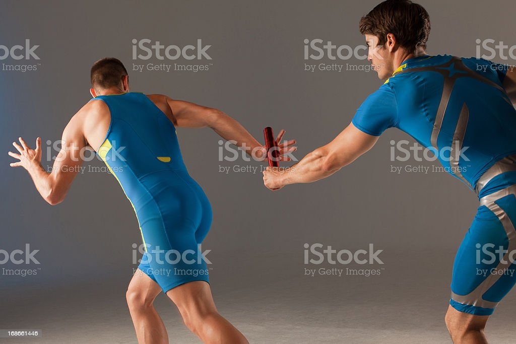 Blurred view of athletes passing baton royalty-free stock photo
