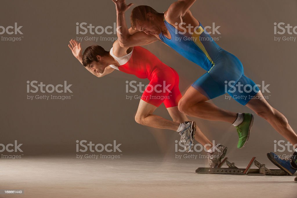 Blurred view of athletes running royalty-free stock photo
