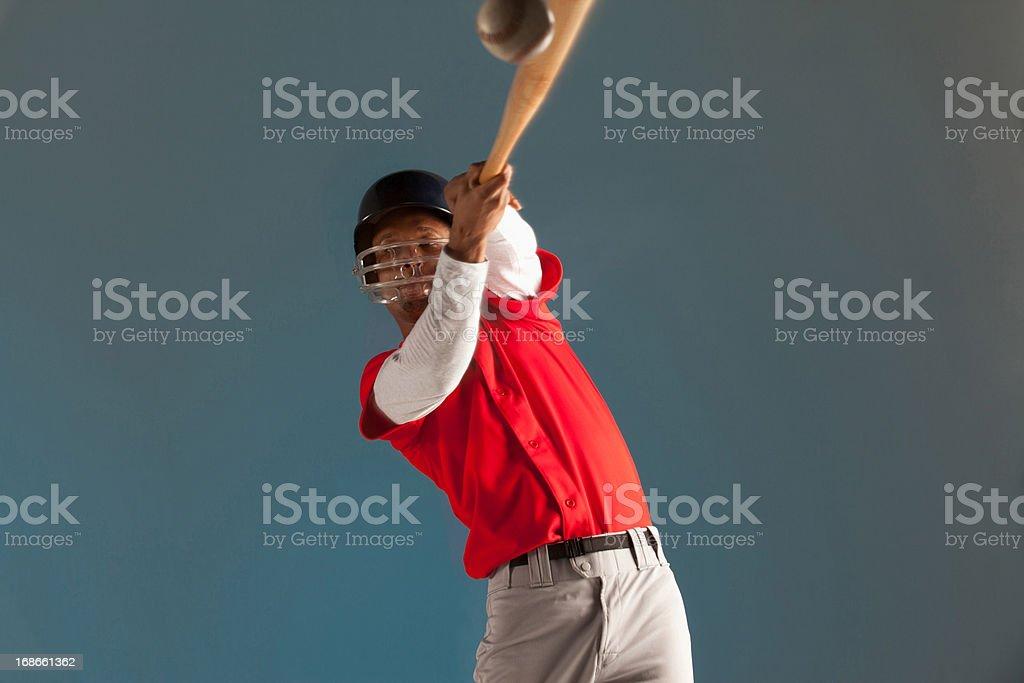Blurred view of baseball player swinging bat royalty-free stock photo