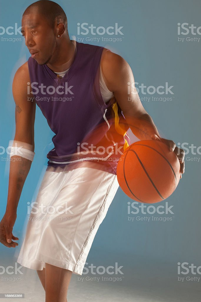 Blurred view of basketball player dribbling royalty-free stock photo