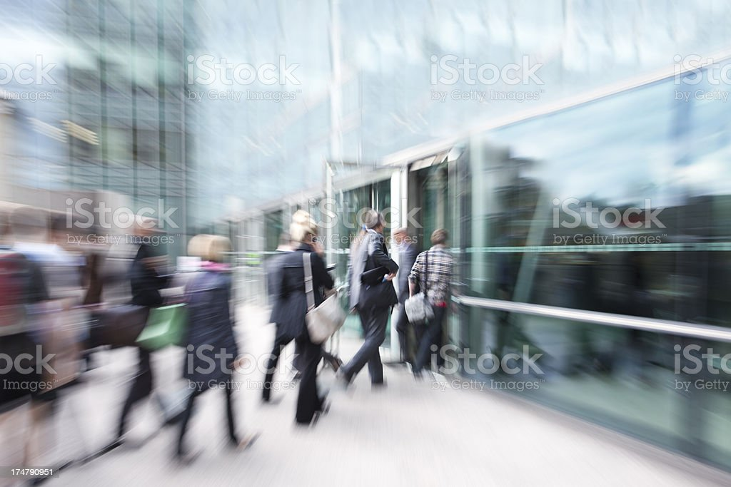 Blurred View of Business People Walking in Financial District stock photo