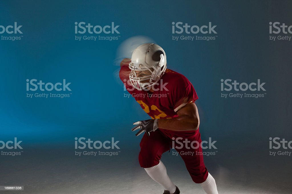 Blurred view of football player running royalty-free stock photo