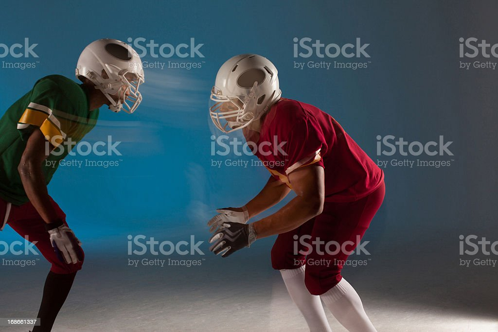Blurred view of football players facing each other royalty-free stock photo