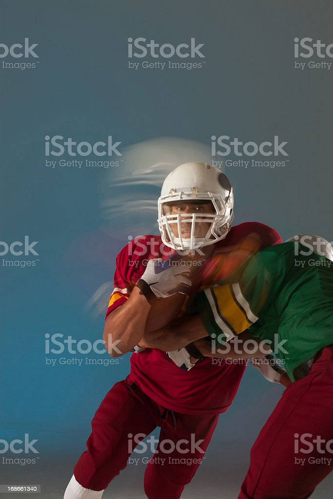 Blurred view of football players with ball royalty-free stock photo