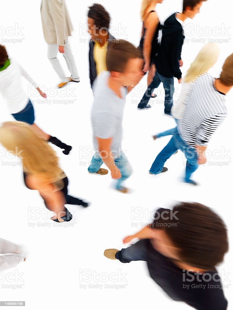 Blurred view of friends walking against white background royalty-free stock photo