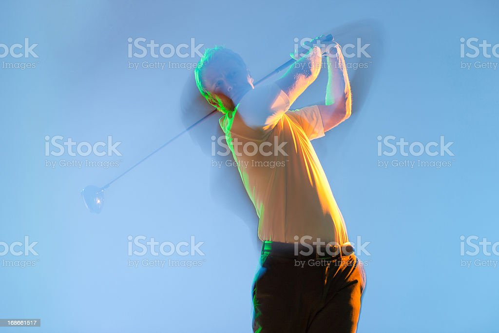 Blurred view of golf player swinging club royalty-free stock photo