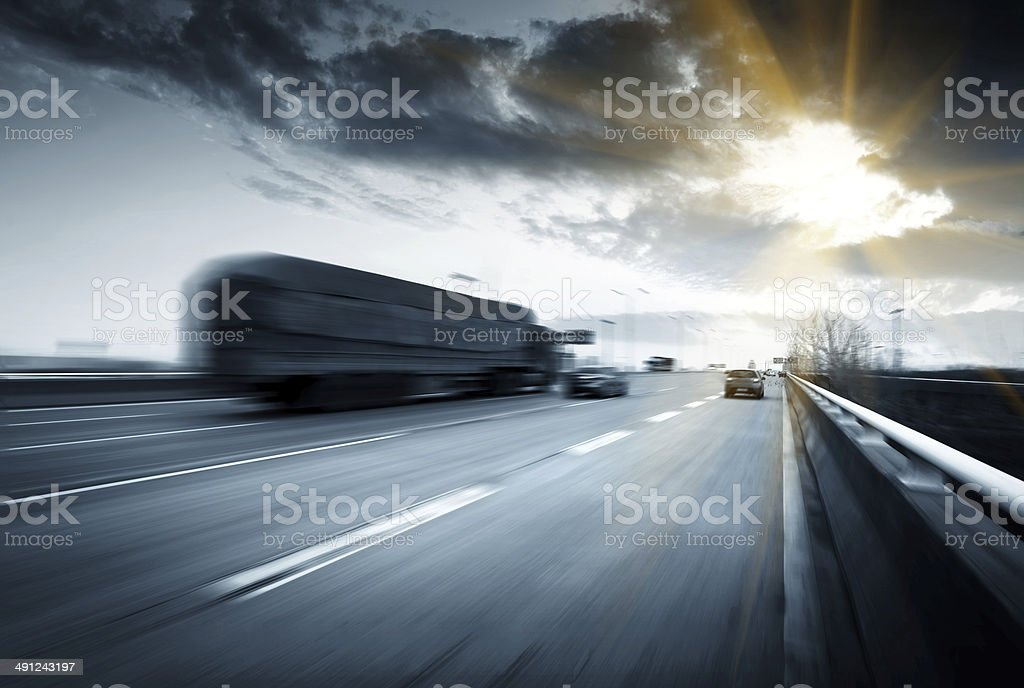 Blurred view of highway under overcast sky stock photo