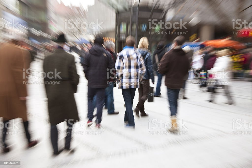Blurred View of People Walking in the City stock photo