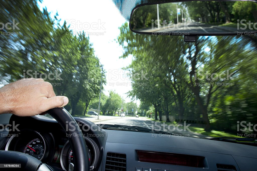 Blurred view through the windshield of a moving car stock photo