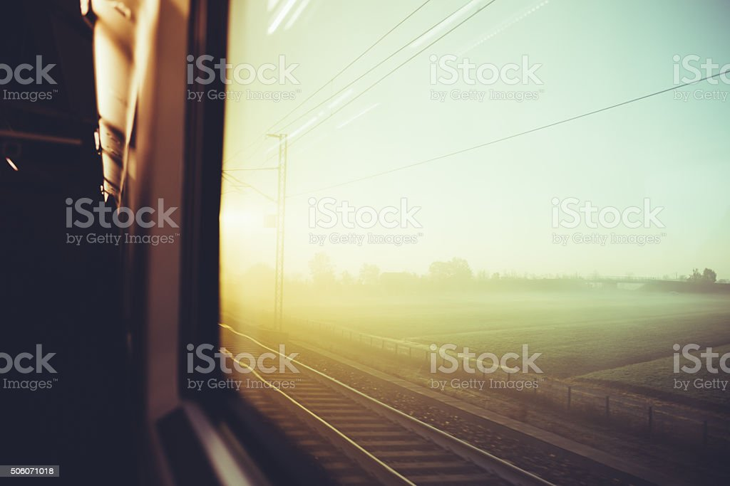 Blurred vintage filtered countryside view by a train window stock photo