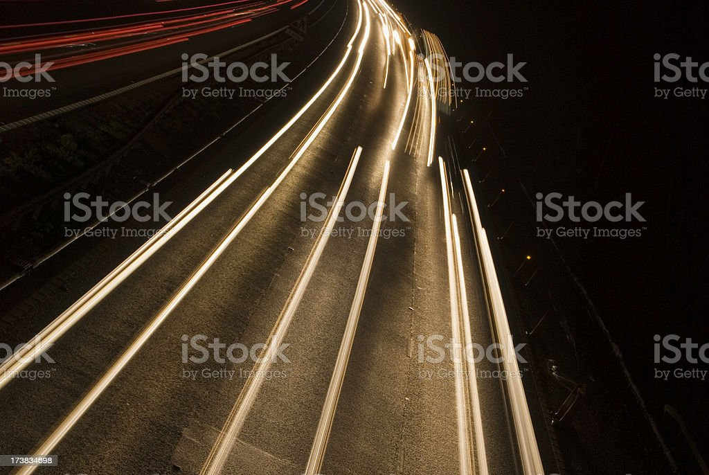 Blurred white lights from fast moving car headlights royalty-free stock photo