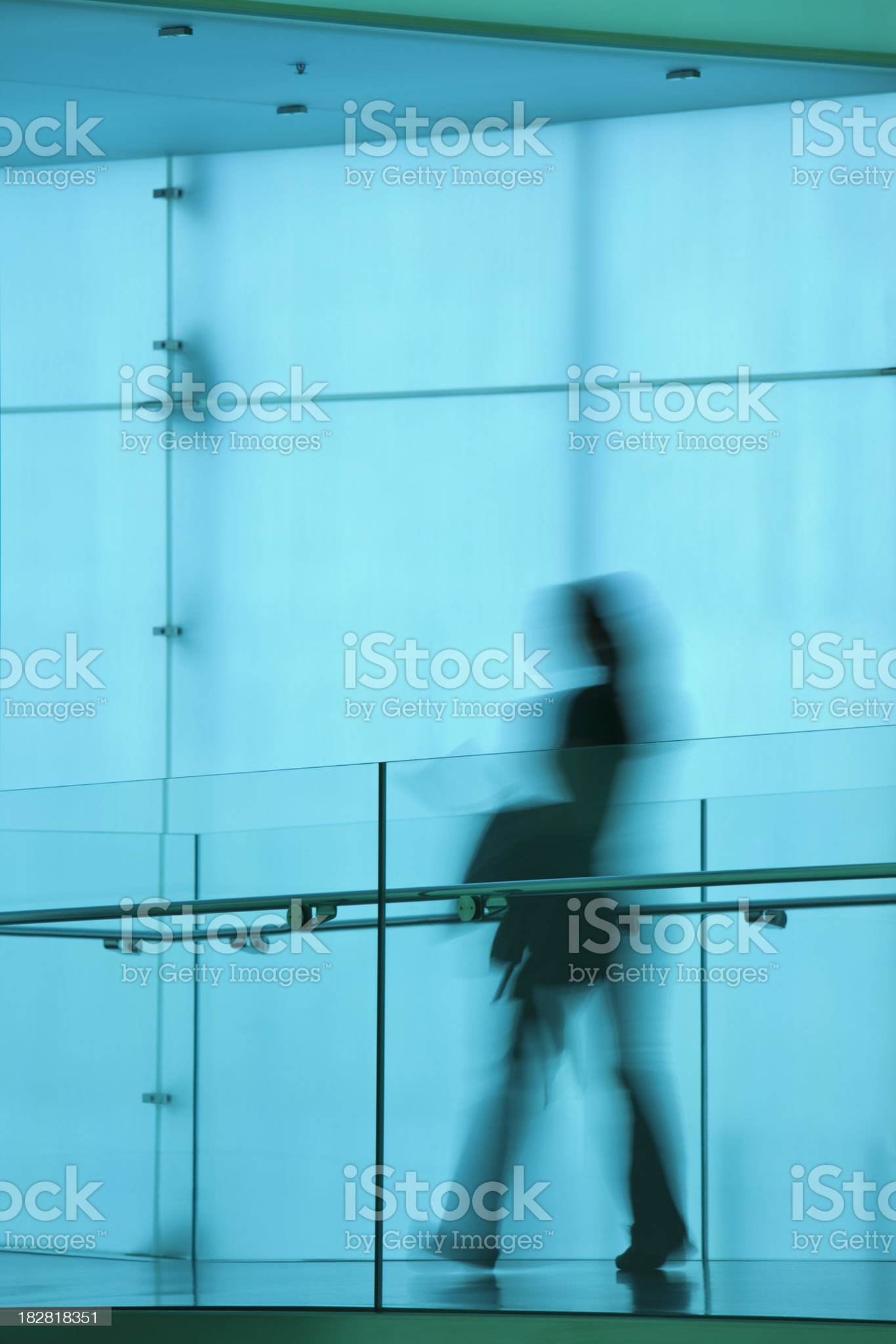 Blurred Woman Walking in Modern Interior royalty-free stock photo