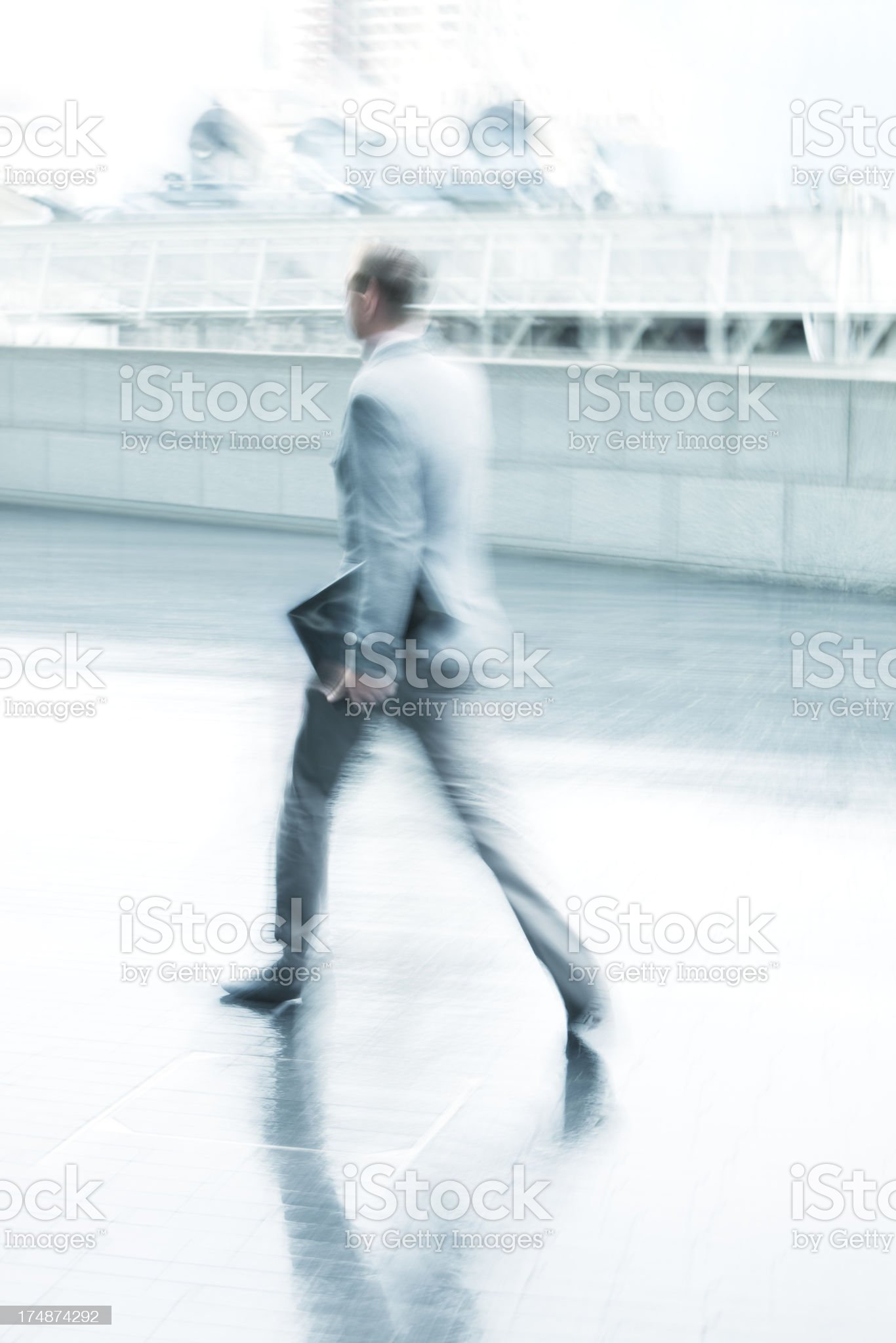 Blurred Young Businessman Walking on Rainy Day in London royalty-free stock photo